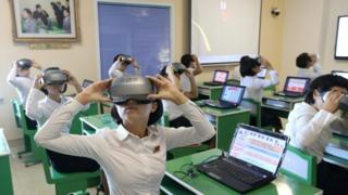 Students use virtual reality headsets at Pyongyang Teachers Training College