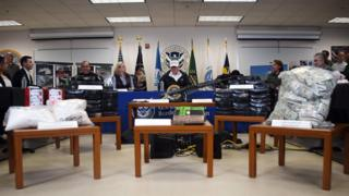 Donald Trump speaks in front of displays of weapons, cash and drugs during a roundtable discussion at the US Border Patrol Station near the US-Mexico border in McAllen, Texas, 10 January 2019