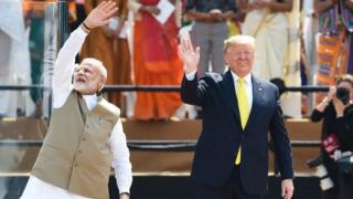 Narendra Modi and Donald Trump wave to the crowd