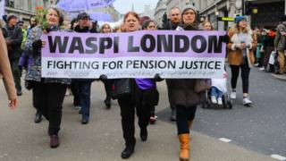 Women with a WASPI (Women Against State Pension Inequality) at the Bread and Roses Women's March on January 19, 2019