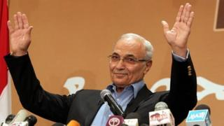 Then-Egyptian presidential candidate Ahmed Shafiq gestures while speaking during a news conference, in Cairo, Egypt, on 21 June 2012