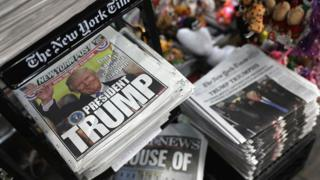 Front pages from New York City newspapers feature the then president-elect Donald Trump