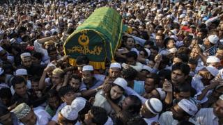 People carry the coffin of a prominent Muslim lawyer Ko Ni