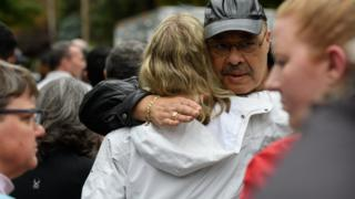 People comfort each other at the site of a mass shooting at the Tree of Life Synagogue in the Squirrel Hill neighborhood on October 27, 2018 in Pittsburgh, Pennsylvania