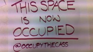 Sign Occupy the Cass