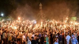 White nationalists participate in a torch-lit march on the grounds of the University of Virginia