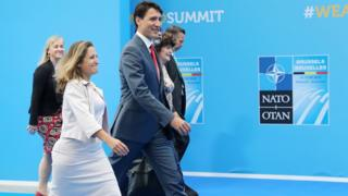 Canada's Foreign Minister Chrystia Freeland (C) and Canadian Prime Minister Justin Trudeau (3R) arrive to attend the second day of the Nato summit in Brussels on July 12, 2018