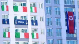 Italian and North Korean flags