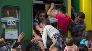 Migrants squeezing onto a train in central Budapest, 3 Sep 15