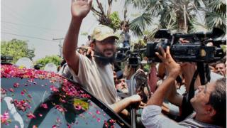 Ali Haidar Gilani, son of former Pakistani Prime Minister Yusuf Raza Gilani waves to media upon arrival at his residence in Lahore, Pakistan, Wednesday 11 May 2016.