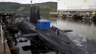 "A nuclear submarine is seen at the Royal Navy""s submarine base at Faslane, Scotland,"