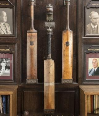 Cricket bats mounted in the principal room of Uppingham School's Cricket Pavilion