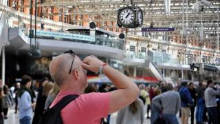 Busy commuters travel through Waterloo station