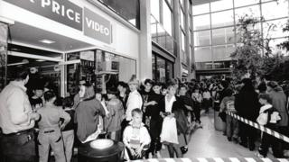 Queues outside a video store