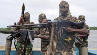 Militants wey carry gun.