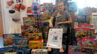 Tatiana Stankovic-Davis with some of the Lego she fundraised to buy
