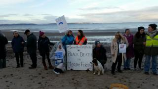 Protestors on Nairn beach