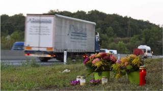 Flowers and candles are left by the side of the A4 motorway, in Nickelsdorf