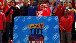 Venezuela's President Nicolas Maduro gestures to supporters during a rally in support of the government in Caracas