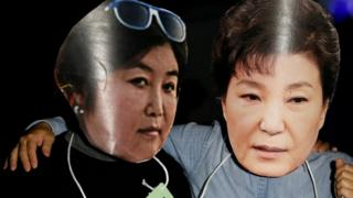 Protesters wearing cut-outs of South Korean President Park Geun-hye (R) and Choi Soon-sil attend a protest - October 27