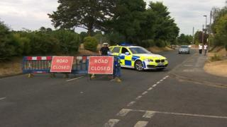 Police car and road closure in Weston Road