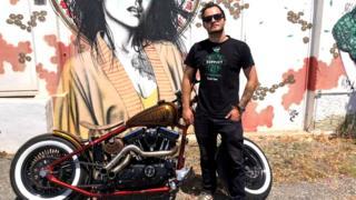 Ben Garland with motorbike