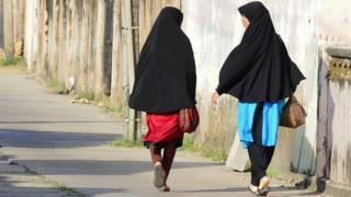On this picture, taken on April 25, 2019, Sri Lankan Muslim girls go with a street in Kattankudy