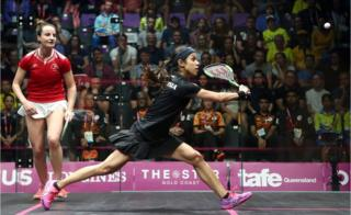 Nicol David of Malaysia competes with Colette Sultana of Malta during the squash preliminary round.