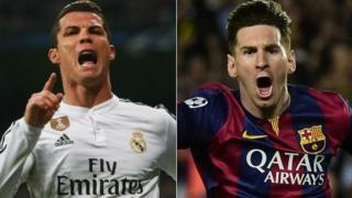 Mchezaji bora duniani Cristiano Ronaldo na aliyeuwa mchezaji bora Lionel Messi wa Barcelona