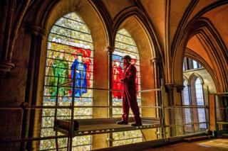 in_pictures Head glass conservator Sam Kelly inspects the Angeli Laudantes and Angeli Ministrantes stained glass windows at Salisbury Cathedral as restoration gets under way.