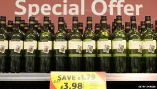 bottles on supermarket shelf