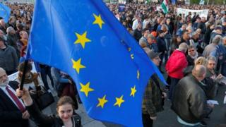 A woman holds a European Union flag during a protest in Heroes square against a new law that would undermine Central European University, in Budapest, Hungary on 12 April 2017.