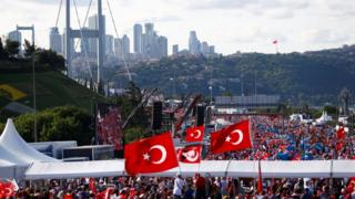 Turks head in their tens of thousands to the bridge in Istanbul that has become a landmark of the failed coup