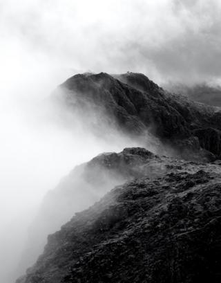 Morning mist lifts on the Aonach Eagach ridge