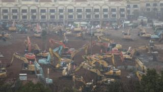 Diggers on the site of the new hospital in Wuhan