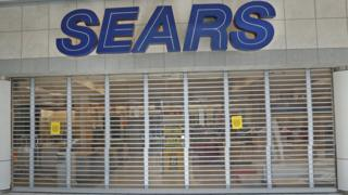 Metal gates block one of the entrances to a Sears store that is closing on September 5, 2017 in Provo, Utah.