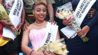 This picture taken on August 30, 2016 shows Ruth Kamande after having been crowned 'Miss Lang'ata Women Prison' in Nairobi as she awaited trial for killing her boyfriend in 2015. - A Kenyan court on July 19, 2018 has sentenced the 24-year-old beauty queen to death for murdering her boyfriend by stabbing him 25 times, drawing criticism from rights groups who called the punishment 'inhumane'. Ruth Kamande, who won a prison beauty pageant while awaiting trial, slashed her partner Farid Mohammed, 24, to death in 2015 and was convicted in May 2018. (Photo by - / AFP) (Photo credit should read -/AFP/Getty Images)