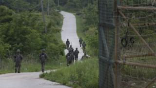 South Korean soldiers patrol the demilitarized zone (June 2016)