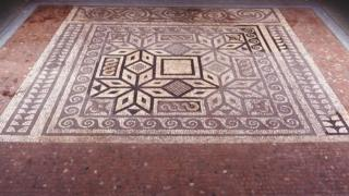 A Roman mosaic which dates back to the second or third century AD and features tiny white, brown and red tiles. It will go on display in St Albans.