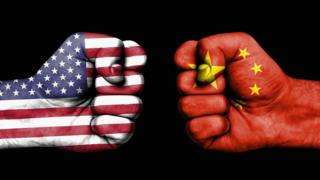 Fists bearing US and Chinese flags clash
