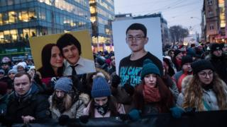 People hold portraits of murdered Slovak journalist Jan Kuciak and his girlfriend Martina Kusnirova during a silent protest march in their memory on March 2, 2018 in Bratislava, Slovakia.