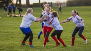 Girls playing rugby