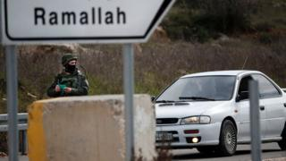 An Israeli soldier checks the documents of the passengers of a Palestinian car on a road leading to the West Bank village of Ein Sinya, northern Ramallah (1 February 2016)