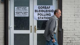 A voter leaves the Martyrs Club polling station on June 23, 2016 in Merthyr