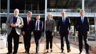 Theresa May and Philip Hammond on a construction site