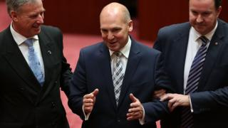 Stephen Parry (centre) being elected president of the Senate in 2014