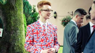 Alexander Willis at his school prom in a suit decorated with Union Jack flags