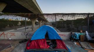 A homeless tent is seen over a bridge in Los Angeles during the coronavirus outbreak