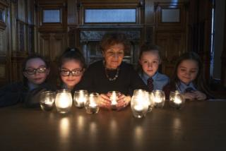 """Year 7 students from St Timothy's Primary School with Holocaust survivor Janine Webber during the """"Stand Together"""" Glasgow Schools"""" Holocaust Memorial event at Glasgow City Chambers."""