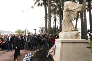 French far-right political party National Front (FN) leader Marine Le Pen (L) lays a wreath at the statue of Joan of Arc during the party's traditional May Day in Cannes, southern France, 01 May 2018.